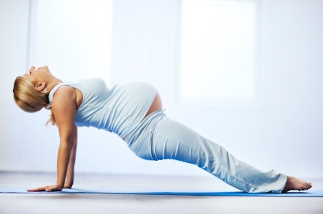 Beautiful pregnant woman doing exercises.